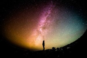 The farthest galaxy in the universe: Chemical signatures give away the distance