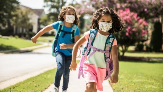 Removing masks 'is not a winning strategy' if goal is in-person school